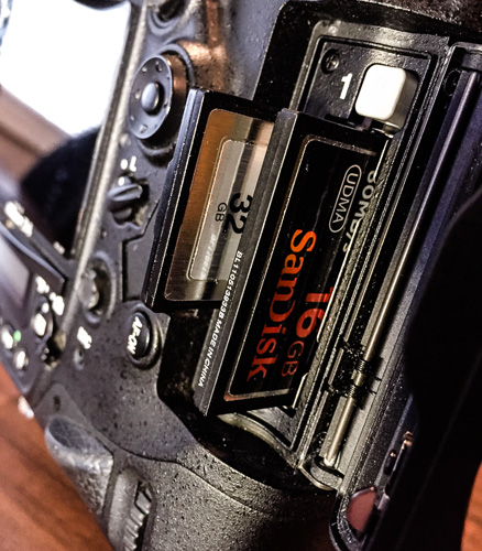 The dual card slots on my Nikon D4 (XQD and CF).